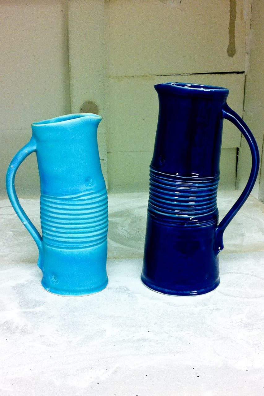 turquoise and blue porcelain bendy jugs by peter downey